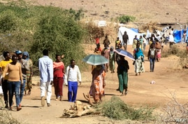 Ethiopian refugees who fled the fighting in Tigray Region are pictured at Umm Rakuba camp in eastern Sudan's Gedaref State, on…