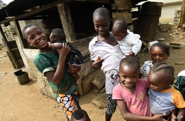 Young Cameroonian refugees carry children in Agborkim town, Etung district of Cross Rivers State, southeast Nigeria, on…