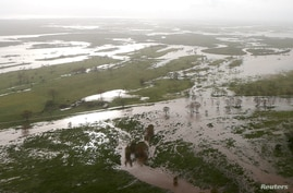 Flooded areas can be seen from an Australian Army helicopter after Cyclone Debbie passed through the area near the town of…
