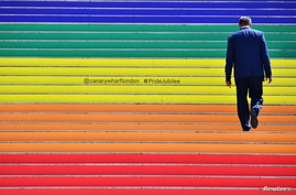 A man walks up some newly decorated staircase at Canary Wharf in London, Britain, July 1, 2019.  REUTERS/Dylan Martinez