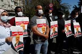 People hold pictures of Saudi journalist Jamal?Khashoggi during a gathering to mark the second anniversary of Khashoggi's…