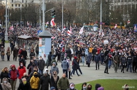 Belarusian opposition supporters walk during a rally to reject the presidential election results in Minsk, Belarus November 1,…