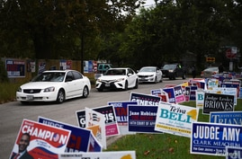 FILE - A line of cars drive in for an event encouraging community members to vote in the upcoming presidential election at an early voting site in Houston, Texas, U.S., Oct. 25, 2020.
