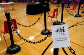 A sign for voters is seen in a polling area ahead of Election Day at the Waterville Junior High School in Waterville, Maine, U…