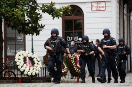 Police officers walk at the site of wreath laying ceremony after exchanges of gunfire in Vienna, Austria November 3, 2020…