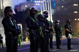 Police officers stand guard outside of Staples Center during Election Day in Los Angeles, California, U.S., November 3, 2020…
