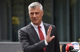 Kosovo's President Hashim Thaci is pictured during a news conference as he resigns to face war crimes charges at a special…