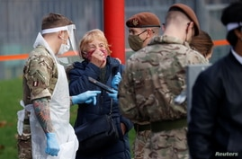 Soldiers are seen outside a coronavirus disease (COVID-19) testing centre in Liverpool, Britain, November 7, 2020. REUTERS/Phil…