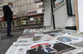 A newspaper with a front picture of U.S. President-elect Joe Biden is seen at a newsstand in Tehran, Iran November 8, 2020…