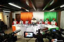 Ivory Coast's President of the Constitutional Council Mamadou Kone gives the final results of Ivory Coast's October 31…