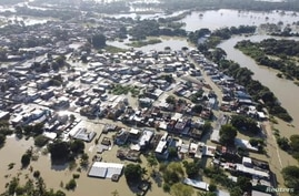 Aerial view shows a neighborhood flooded in the aftermath of Tropical Storm Eta and cold fronts, in Macuspana, Tabasco, Mexico, Nov. 9, 2020 in this drone picture obtained from social media.