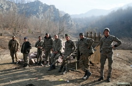 Ethnic Armenian soldiers are seen in the village of Knaravan located in a territory which is soon to be turned over to…