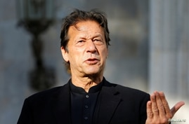 Pakistan's Prime Minister Imran Khan speaks during a joint news conference with Afghan President Ashraf Ghani (not pictured) at…