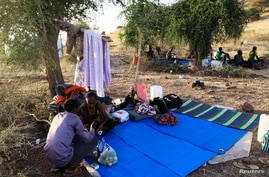 Ethiopians who fled war in Tigray region, rest under trees with their belongings at the Um-Rakoba camp on the Sudan-Ethiopia…