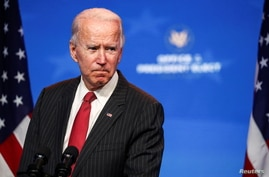 President-elect Joe Biden speaks to reporters following an online meeting with members of the National Governors Assoc.