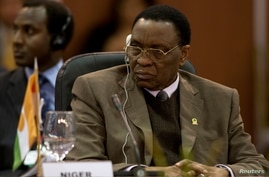 FILE - Niger's President Mamadou Tandja attends the plenary session of the Africa-South America Summit.