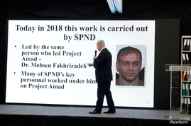 Israeli Prime Minister Benjamin Netanyahu points at a screen with an image of Iranian nuclear scientist Mohsen Fakhrizadeh during a news conference at the Ministry of Defence in Tel Aviv, April 30, 2018.