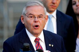FILE – In this Nov. 16, 2017, file photo, U.S. Sen. Bob Menendez speaks to reporters after U.S. District Judge William H. Walls…