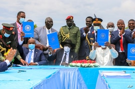CORRECTS IDRIS TO IDRISS - Seated from left, the head of Sudan's sovereign council, Gen. Abdel-Fattah Burhan, President of…