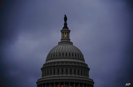 The light in the cupola of the Capitol Dome signals that the Senate remains in session overnight as 30 hours of time must…