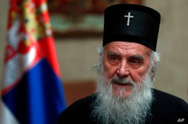 FILE -In this file photo taken Sunday, March 15, 2020, Serbian Patriarch Irinej speaks during a statement with Serbian…