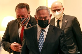 From left to right, U.S. Secretary of State Mike Pompeo, Israeli Prime Minister Benjamin Netanyahu and Bahrain's Foreign…