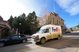 A FedEx delivery van passes by the opera house on Wednesday, Nov. 18, 2020, in the gaming town of Central City, Colo. (AP Photo…
