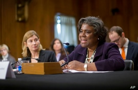 FILE - In this Jan. 9, 2014, file photo Assistant Secretary of State for African Affairs Linda Thomas-Greenfield, right,…