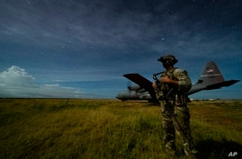 U.S. Army Spc. Kevin Martin, junior sniper, assigned to the 1-186th Infantry Battalion, Task Force Guardian, Combined Joint…