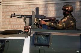 Indian security officers keep guard near the site of an attack on the outskirts of Srinagar, Indian controlled Kashmir,…