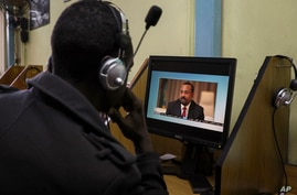 An Ethiopian streams a video of Prime Minister Abiy Ahmed speaking, at an internet cafe in the capital Addis Ababa, Ethiopia…