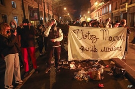 """FILE - In this Tuesday, Nov.24, 2020 file photo, demonstrators march with a banner that reads """"Vote for Macron they said"""",…"""