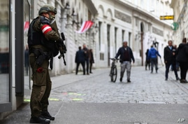 A military police officer guard at the crime scene near a synagogue in Vienna, Austria, Wednesday, Nov. 4, 2020. Several shots…