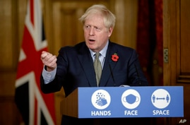 Britain's Prime Minister Boris Johnson speaks during a virtual press conference on the coronavirus pandemic at 10 Downing…