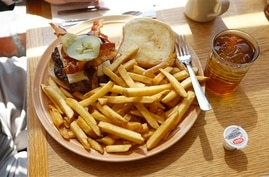 In this April 16, 2015 photo, a bacon cheeseburger with french fries is served at the Howard Johnson Restaurant in Bangor, Maine.