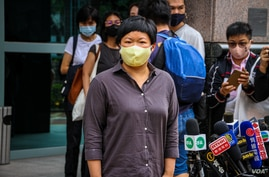Bao Choy is pictured outside Fanling Magistrates Court after her hearing, Nov. 10, 2020. (Tommy Walker/VOA)
