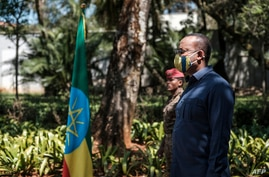FILE - Prime Minister of Ethiopia Abiy Ahmed stands during an event honoring the national defense forces, in Addis Ababa, Nov. 17, 2020.