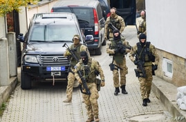 Soldiers of the European Union Rule-of-Law (EULEX) in Kosovo carry out special operations at the house of the former Parliament speaker of Kosovo and former Kosovo Liberation Army (KLA) spokesman Jakup Krasniqi in Pristina, Nov. 4, 2020.