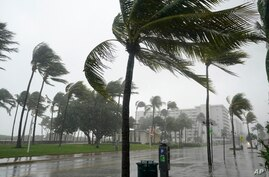 Ocean Drive is seen during a downpour in Miami Beach, Florida, Nov. 8, 2020. A strengthening Tropical Storm Eta cut across Cuba Sunday, and forecasters say it's likely to become a hurricane before Florida Sunday night or Monday morning.