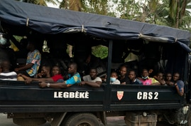 Opposition supporters are seen in a police truck in Abidjan, Ivory Coast, Nov. 3, 2020, during a protest challenging the results of a controversial Oct. 31 election.
