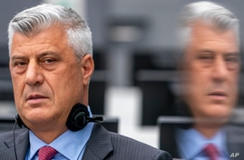 Hashim Thaci, who resigned as Kosovo's president to face charges including murder, torture and persecution, makes his first courtroom appearance before a judge at the Kosovo Specialist Chambers court in The Hague, Netherlands, Nov. 9, 2020.