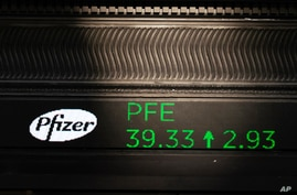 A stock ticker with Pfizer stock information is shown at the New York Stock Exchange, Nov. 9, 2020.