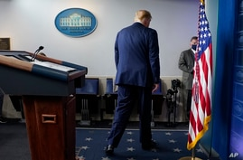 FILE - President Donald Trump walks away after speaking at the White House, in Washington, Nov. 5, 2020.