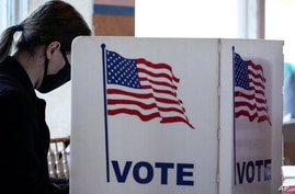 A young voter casts her ballot on Election Day in Atlanta, Georgia, Nov. 3, 2020.