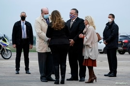 U.S. Secretary of State Mike Pompeo and his wife Susan Pompeo speak with Jacques Jouslin de Noray of the French Foriegn Ministry and U.S. Ambassador to France Jamie McCourt at Paris-Le Bourget Airport, in Le Bourget, France, Nov. 14, 2020.