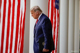 U.S. President Donald Trump walks down the West Wing colonnade from the Oval Office to the Rose Garden to speak to the press, at the White House in Washington, Nov. 13, 2020.