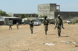 Members of the Amhara Special Force return to the Dansha Mechanized 5th division military base after fighting against the Tigray People's Liberation Front, in Danasha, Amhara region near a border with Tigray, Ethiopia, Nov. 9, 2020.