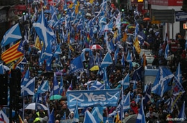 Demonstrators march for Scottish Independence through Glasgow City center in Scotland, Jan. 11, 2020.