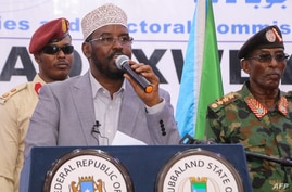 "Ahmed Mohamed Islam better known as ""Ahmed Madobe"" (C), speaks after his reelection as President of Jubaland, a semi-autonomous…"