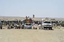 Afghan traders and citizens gather near the Pakistan's newly inaugurated BadiniTradeTerminalGateway, a border crossing point…